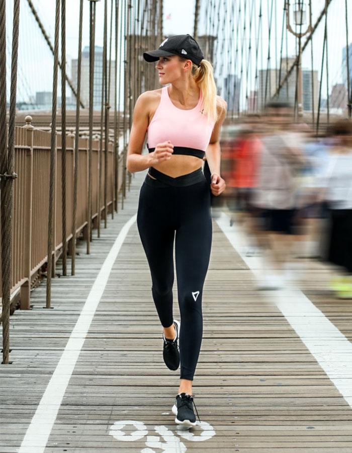 Woman, jogging across Brooklyn Bridge