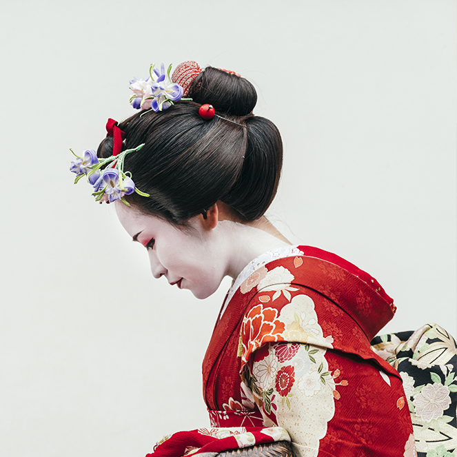 Woman wearing a red kimono with japanese pattern